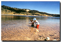 Children playing at Navajo Lake on Cedar Mountain