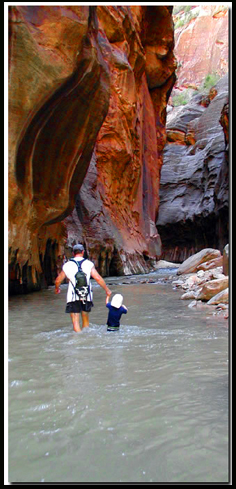 Kids in Zion:  Father and son enjoy hiking in the Zion Narrows