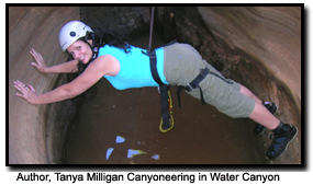Author Tanya, with friend Alex canyoneering in Zion.